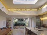Pop up clerestory lantern light over family kitchen and dining space looking through to the garden and bi-folding doors